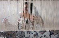 iranian woman in rugs weaving